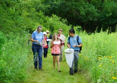 BioBlitz volunteers walking on a trail